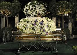 Celebrity funerals with open caskets of celebrities